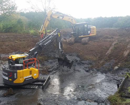 Entschlammung eines Regenrückhaltebeckens durch Blunk-Team